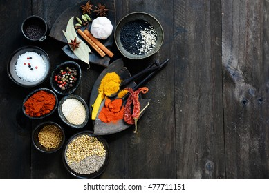 Exotically Spice Mix - spice, herbs, powder. Colorful spices on wooden background with copy space for text.