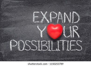 expand your possibilities phrase written on chalkboard with red heart symbol instead of O
