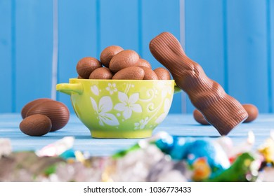 Expanded chocolate rabbit and a full bowl of Easter eggs