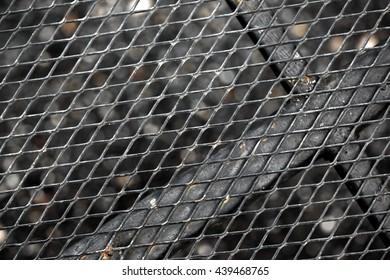 Expanded metal floor, metal mesh.