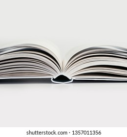 Expanded thick book on a white background
