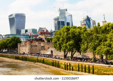 An expanded view of Tower of London surrounded by Skyscrapers of the City of London