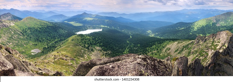 Expanse of the Sayan Mountains, Natural Park Ergaki. Siberian nature, traveling in Russia. Wide panoramic view.