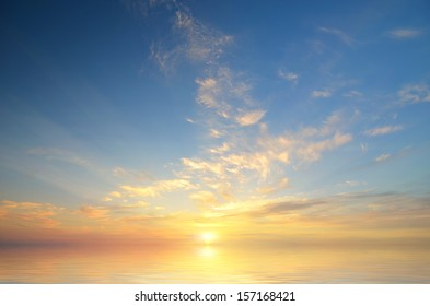 Expanse of the sea against the sunset sky. Beautiful seascape. Natural composition.