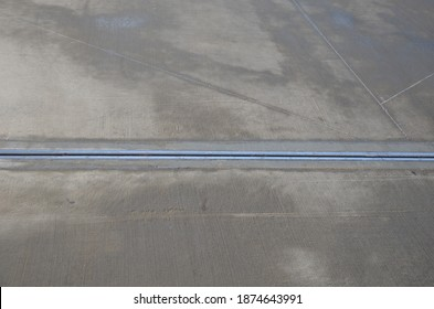 expansion joint on the concrete roof which serves as a parking lot. dilatation consists of a rubber strip with a metal stainless steel cover