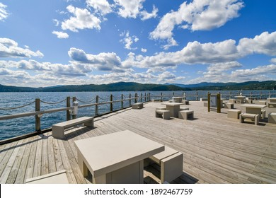 An expansive deck along Lake Coeur d'Alene, part of the world's longest floating boardwalk at the resort at Coeur d'Alene, Idaho, USA