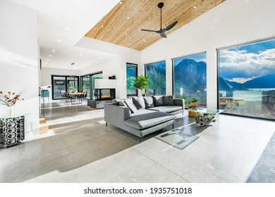 expansive living room with floor to ceiling windows, mountain view and fireplace
