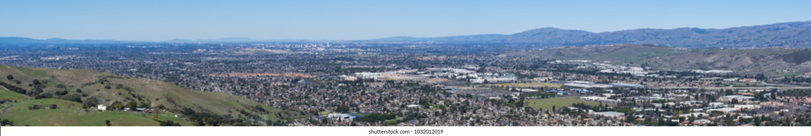 Expansive panorama of the business and residential areas of south San Jose; downtown San Jose in the background; Santa Clara county, San Francisco bay area, California
