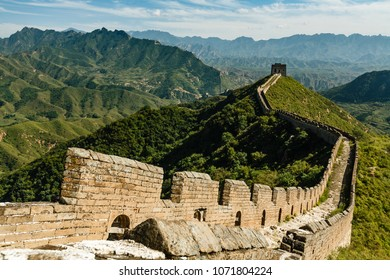 Expansive view of stretch of the Great Wall of China and green mountainous countryside