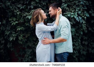 Expecting couple embracing in the park