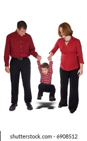 Expecting parents swinging toddler boy by his arms isolated over a white background