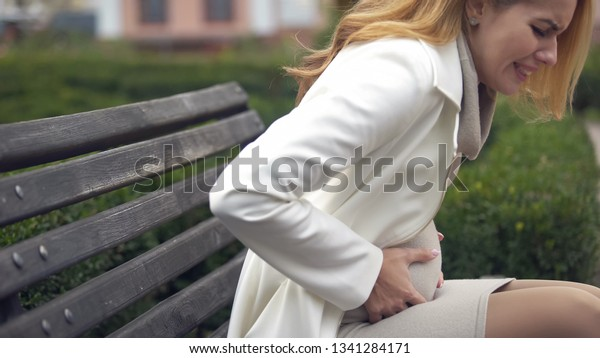 Expecting Woman Suffering Sudden Sharp Pain Stock Photo