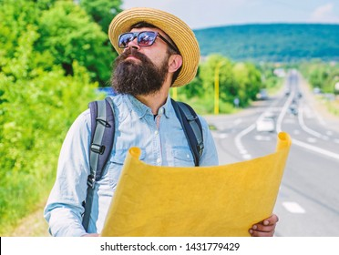Expeditor backpacker map look direction travelling. Around world expedition. Map helps find right direction if get lost. Where should I go. Expeditor looking for side of the world direction map.