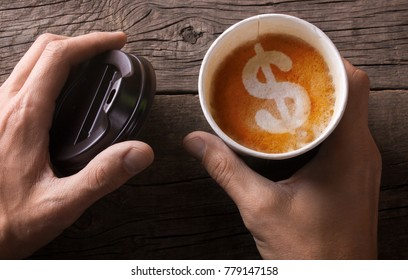 Expensive black coffee take-out. Business for sale of coffee. The man is holding a mug of coffee with foam in the form of a dollar sign.