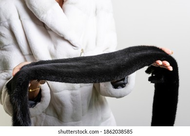 Expensive brown mink fur skin in a woman hands.