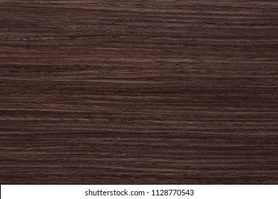 Expensive brown wenge veneer texture for your ideal interior. High resolution photo.