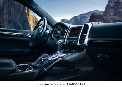 Expensive car interior with steering wheel, multimedia and gearbox handle