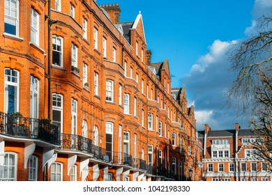 Expensive Edwardian block of period red brick apartments typically found in Kensington, West London, UK.