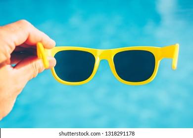 Expensive fashion accessories - sunglasses - beachwear for the sea