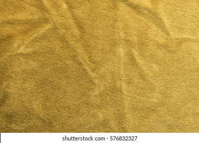 Expensive golden angora goat velour fabric mixed with silk fibers. mohair textile. cashmere, velvet suede and chamois effect. for upholstery and clothing use.