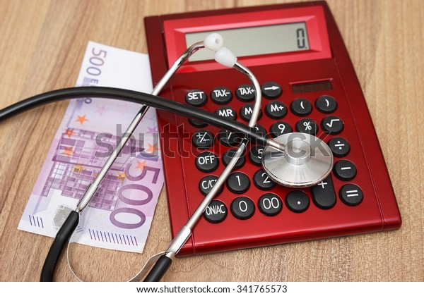 Expensive health care concept with calculator,money and stethoscope