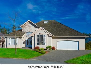 Expensive luxury home against a blue sky in an autumn season