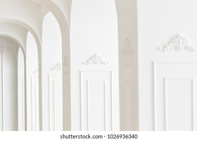 Expensive luxury interior. focus on the middle. Stucco elements on line of light columns. White patterned. Mouldings element from gypsum. Roccoco style