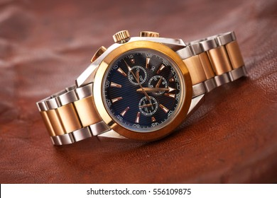 Expensive man wrist watch leather background