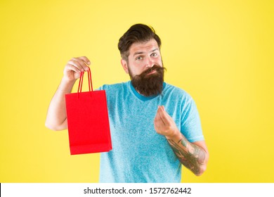 too expensive. mature male beard with fashion purchase. sad hipster hold paperbag. Man with gift package. Buy product. little pleasantness. bearded man go shopping. mall for men. high price.