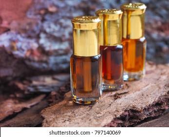 Expensive oil agarwood tree. Small bottle of Arabian Attar.
