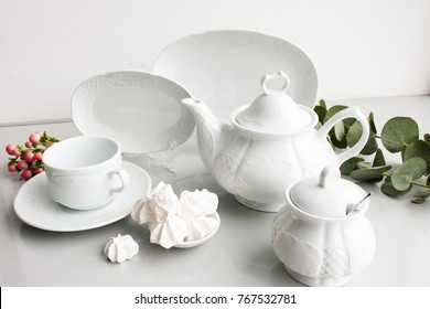 Expensive porcelain tea set on white background. Proper quality dishes concept