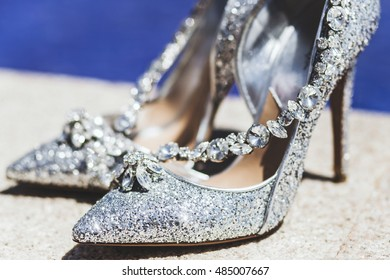 Expensive shoes with jewelry shine in the sun