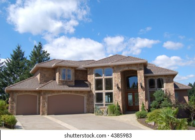 Expensive Suburban Home on Sunny Day
