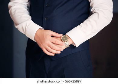 expensive watch on hand of business man