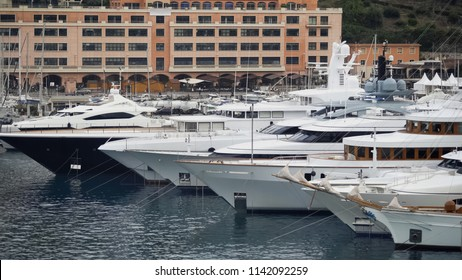 Expensive white yachts docked in harbor, luxury property of rich powerful people