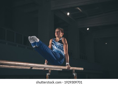 Experience. Little male gymnast training in gym, composed and active. Caucasian fit boy, athlete in sportswear practicing in exercises for strength, balance. Movement, action, motion, dynamic concept