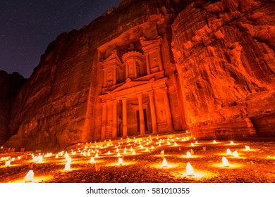 Experience Petra by night by walking the entire Siq to the Treasury to see part of the rock city by candlelight with over 1,500 candles, Petra, Jordan.