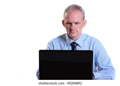 Experienced businessman concentrating on his laptop