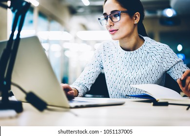 Experienced businesswoman reading publication via laptop computer making research for planning startup at desktop,female secretary checking mail on netbook organizing working process in office