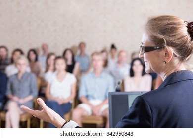 Experienced businesswoman is speaking during training for workers