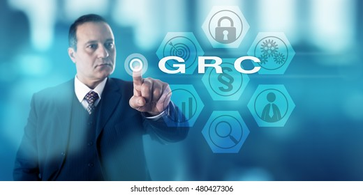 Experienced corporate governance officer is activating GRC onscreen. Business concept and information security metaphor for Governance, Risk Management and Compliance procedures and processes.