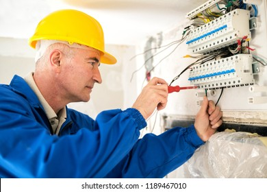 Experienced electrician doing electrical work with high precision and neatness