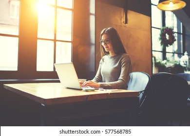 Experienced female freelancer typing message in online chat having internet conversation with manager requiring report about completed tasks and projects to get salary payment via laptop computer