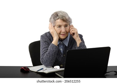 Experienced female teacher sets up her own tutoring business in internet. Aged woman talking by mobile phone waiting on-line lesson.