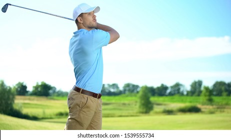 Experienced golf player performing swing hitting ball at course, luxury hobby