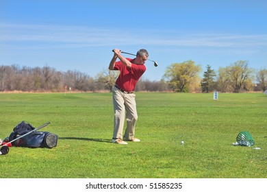 Experienced golf player warming-up before the game