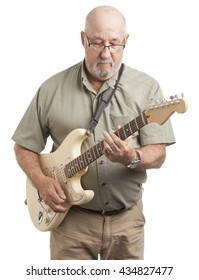 Experienced man playing electric guitar over white background.