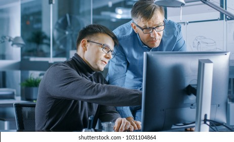 Experienced Senior Engineer Consults Young Designer about Project, They Have Discussion and Work on a Personal Computer.