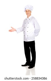 Experienced smiling chef with welcome gesture