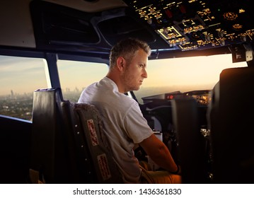 experienced young pilot in the cockpit of the plane